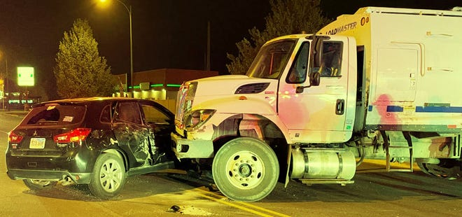 At 3:45 a.m. Wednesday, this garbage truck struck an SUV traveling in the 10th block of 1st Avenue NE. A passenger in the SUV incurred minor injuries.