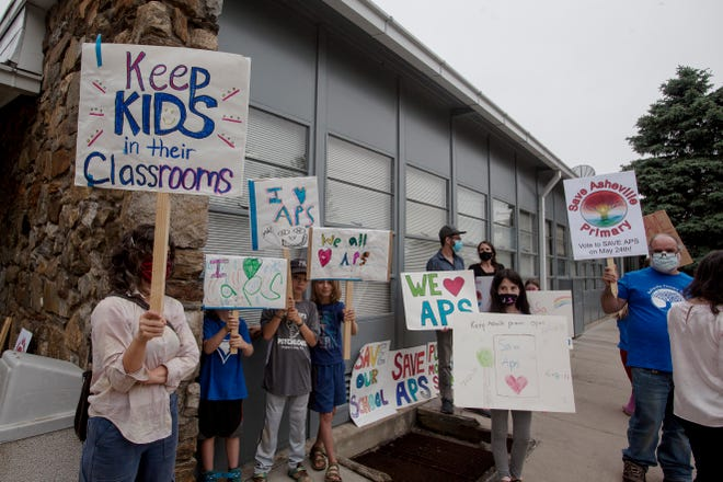 Outside the May 18 Asheville City Schools Board of Education's specially called work session, more than 25 parents, students and community members gathered to protest the potential closure of Asheville Primary School.