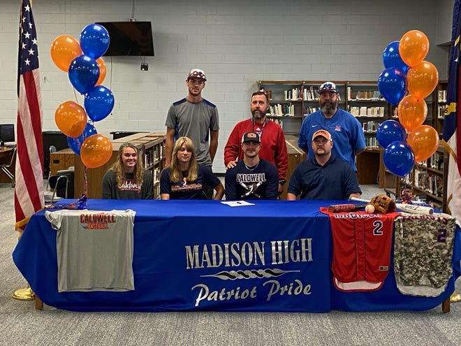 Madison High's Joseph Rice poses with friends, family and coaches after he announced his commitment to play baseball at Caldwell Community College and Technical Institute.