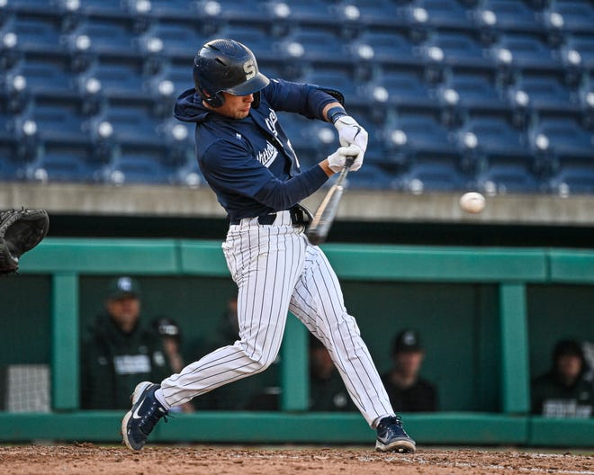 Penn State's Gavin Homer takes a swing during a game with Michigan State. Homer, a Lakeview High School graduate, is finishing up his college career this month.