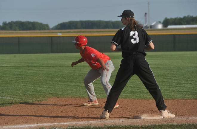 Buckeye Central's Manny Mullins cheats off first base toward second.