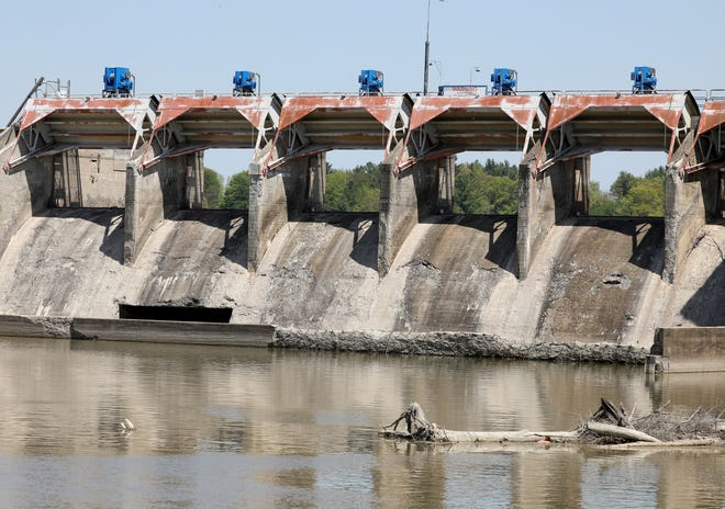The Sanford Dam in Sanford on May 18, 2021.  One year ago this dam and the Edenville Dam upstream collapsed sending much of the rushing lake water where it flooded many homes and businesses.