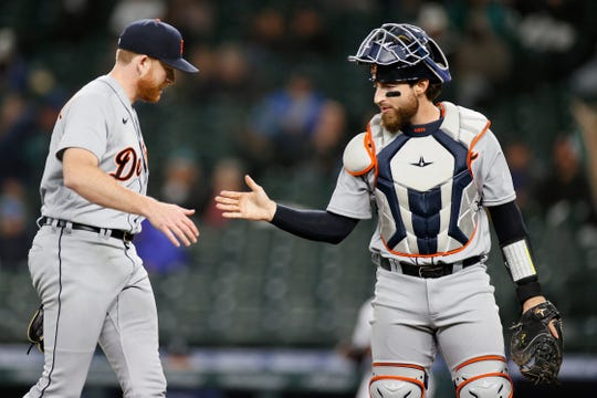 Spencer Turnbull #56 and Eric Haase #13 of the Detroit Tigers celebrate after the fourth inning against the Seattle Mariners at T-Mobile Park on May 18, 2021.