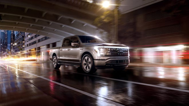 The 2022 Ford F-150 Lightning Platinum edition. The electric pickup is a cornerstone of Ford's $22-billion investment in EVs that began with the Mustang Mach-E sporty SUV last year. The F-150 Lightning has standard four-wheel drive and two electric motors developing 563 hp and 577 lb-ft or torque. The most obvious outer changes include LED head and tail lights and light bars running the full width of the hood and tailgate.