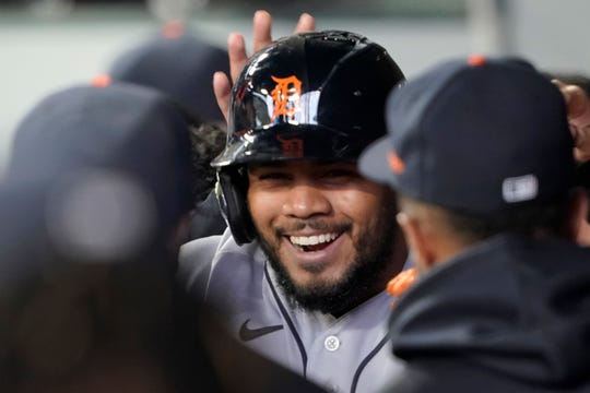 Detroit Tigers' Jeimer Candelario is greeted in the dugout after he hit a solo home run against the Seattle Mariners during the first inning of a baseball game Tuesday, May 18, 2021.