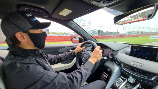 Helio at the wheel of the 2021 Acura TLX Type S