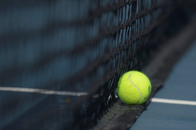 A tennis ball on the court during a match at Poudre on Tuesday, May 18, 2021.