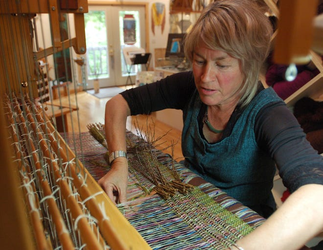 Wendy Carpenter, owner of Interfibers Studio Gallery in Fish Creek, spends about 100 hours on each of her fiber art pieces.