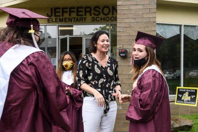 Henderson County High School senior Khierstin Moore, right, reacts as one of her elementary school teachers Allyson Fleck, center, tells her how proud she is of the graduate following the senior walk-through at Jefferson Elementary School in Henderson, Ky., Tuesday morning, May 18, 2021. Fleck moved to Chicago last year, but decided to come back to Henderson for a quick visit to see family, friends and celebrate the 2021 graduates.