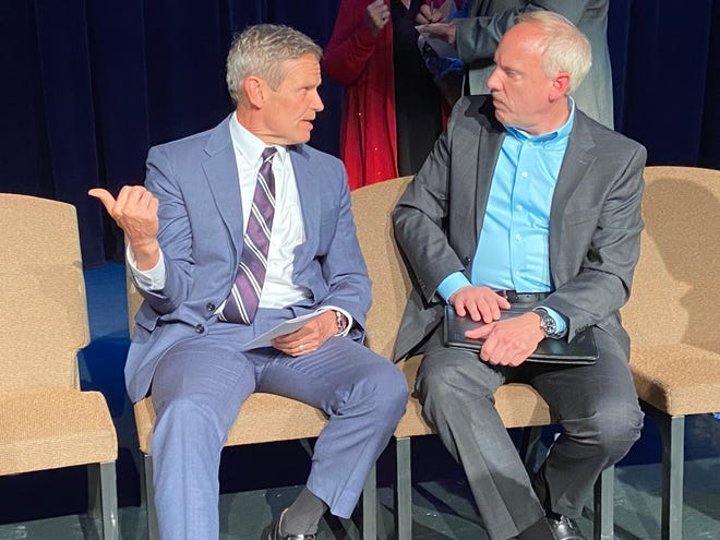 Tennessee Governor Bill Lee and Hydro-Gear CEO Ray Hauser talk after a post-press conference photo opportunity on Tuesday at The Dixie Carter Performing Arts Center in Huntingdon.