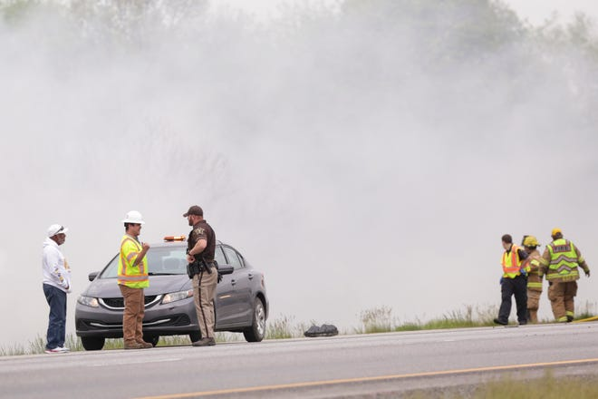 Emergency crews work the scene of a vehicle fire on I-65 Southbound near the 182 mile marker, Wednesday, May 19, 2021 in Tippecanoe County.
