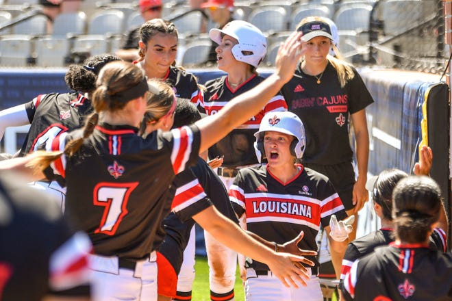 Ragin' Cajuns outfielder Julie Rawls celebrates as she makes her way to the dugout during UL's Sun Belt Conference Tournament championship game win over South Alabama last Saturday in Troy, Alabama.