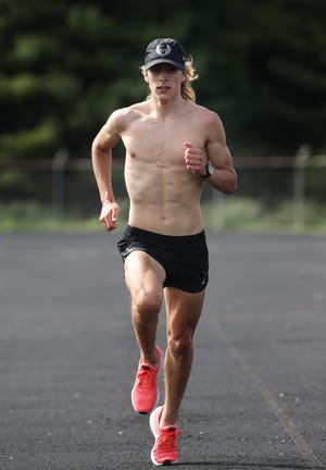 Jimmy Mullarkey, a junior at the Fern Creek High School, does 100 Meter runs during practice at the school in Louisville, Ky. on May 18, 2021.  Mullarkey just recently broke the school record in the 800 Meter run.