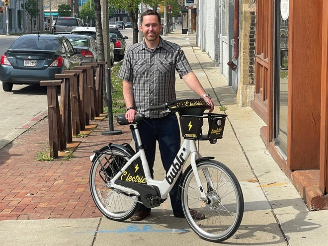 James Davies, executive director of Bublr Bikes, with a new e-bike which will be placed into the fleet in July