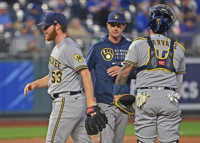 Brewers manager Craig Counsell relieves starting pitcher Brandon Woodruff during the eighth inning.