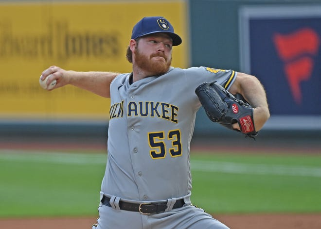 Brewers starting pitcher Brandon Woodruff pitches in the first inning.