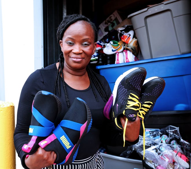 Dorothy Smith shows some of the many donations she has received to give to those in need in her community.  The night her car was stolen, theback seat and trunk were filled with clothing, shoes and other donated items.After Smith was featured in a column by James Causey, a donor paid her car off.