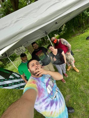 """Residents in Dover and the surrounding areas started a petition to allow cannabis businesses to operate in Dover. In May, they held a """"burn-up"""" community clean-up to share their petition with other Dover residents."""