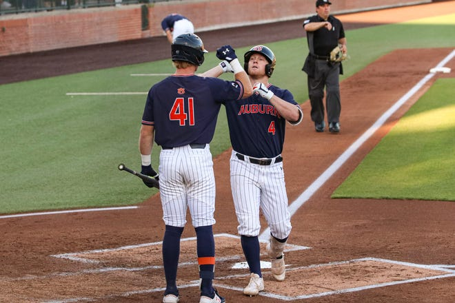 Feb 19, 2021; Auburn, AL, USA; Auburn Tigers infielder Rankin Woley (4) reacts with Auburn Tigers outfielder Steven Williams (41) after a home run during the game between Auburn and Texas A&M at Plainsman Park. Mandatory Credit: Jacob Taylor/AU Athletics