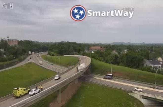 An overturned vehicle at the I-40 and I-65 interchange closed I-40 westbound on Wednesday morning.