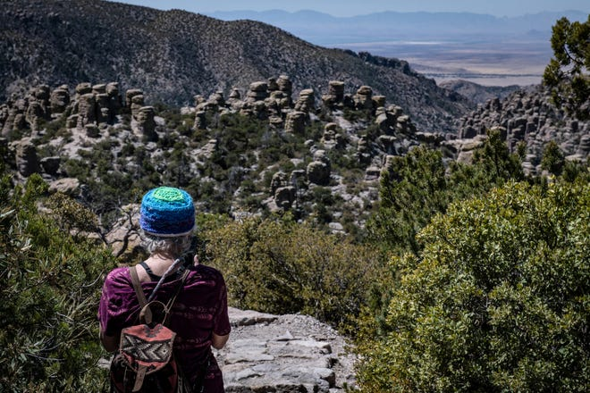 """Rosemary Dupray looks out at the valley below the Chiricahua National Monument near Wilcox, Ariz, April 2, 2021. Dupray was part of  a Western Institute for Lifelong Learning class """"Visit and Hike the Chiricahua National Monument"""" from Silver City, N.M."""