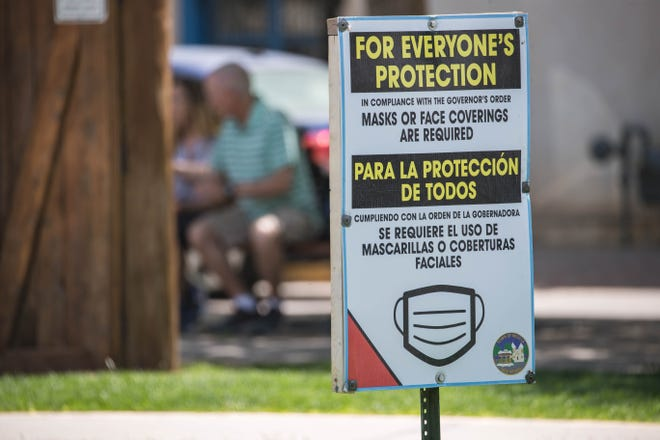 A sign in Mesilla Plaza asks people to wear a mask in Mesilla on Wednesday, May 19, 2021.