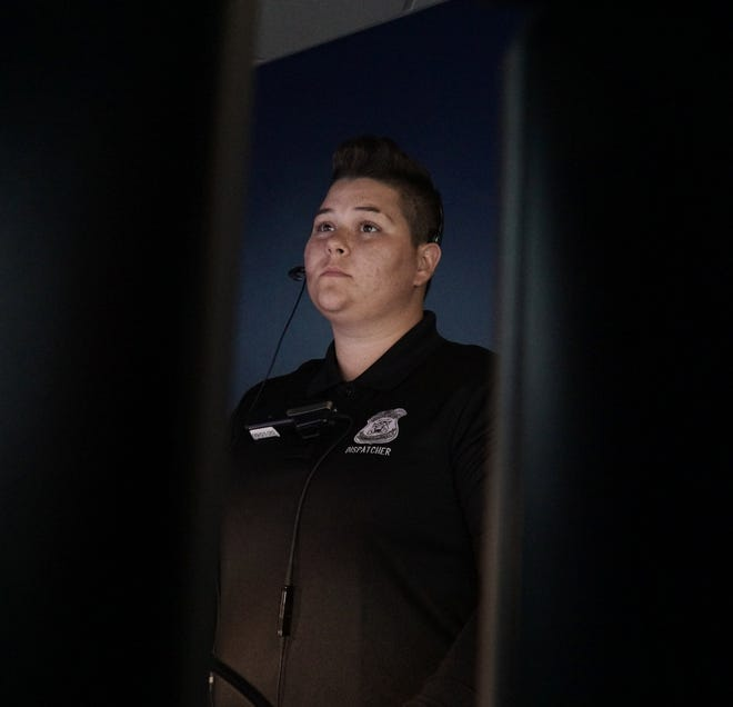 Farmington Hills' dispatcher Caitlyn Bailey monitors her screens inside the police department on May 19, 2021.