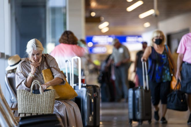 A passenger waits in Terminal 3 at Sky Harbor International Airport in Phoenix, Ariz. on May 19, 2021.