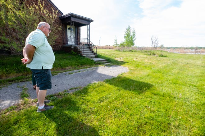 Clay Township Supervisor Artie Bryson talks about the property for the county's beachfront park Wednesday, May 19, 2021. St. Clair County received a $1.4 million grant from the state to buy the property.