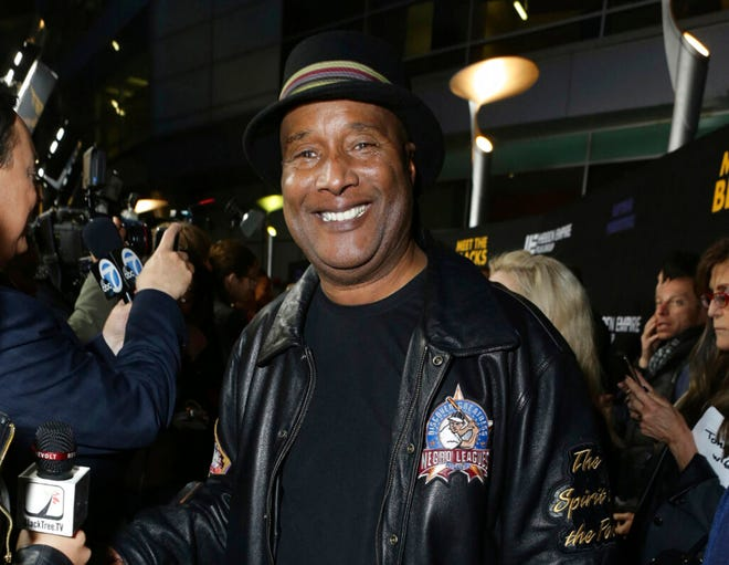 """This March 29, 2016 image released by Meet The Blacks, LLC shows Paul Mooney posing at the premiere of """"Meet the Blacks"""" in Los Angeles. Mooney, a boundary-pushing comedian who was Richard Pryor's longtime writing partner and whose sage, incisive musings on racism and American life made him a revered figure in stand-up, died of a heart attack at his Oakland, Calif. home on Wednesday. He was 79.(Eric Charbonneau/Meet The Blacks via AP)"""