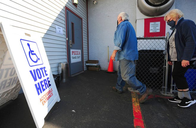 Voters arrive to cast their ballots for the primary election at the Dupont VFW in Dupont, Pa., on Tuesday, May 18, 2021. (Mark Moran/The Citizens' Voice via AP)