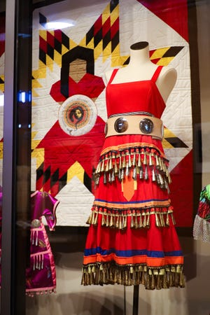 """Turtle Bay Exploration Park presents """"The Jingle Dress,"""" an exhibit of Native American women's ceremonial clothing. The red jingle dress and dance have been adopted by those at the forefront of the Missing and Murdered Indigenous Women movement."""
