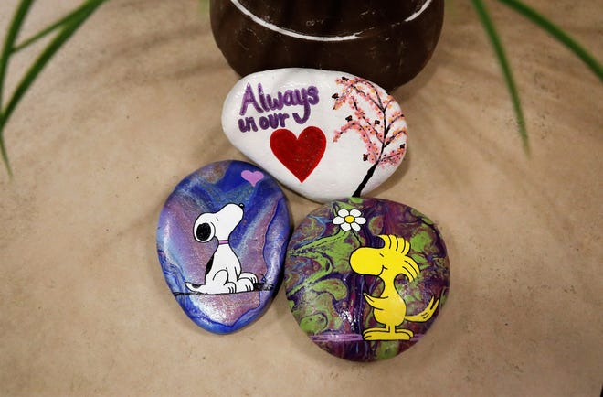 Former middle school teacher Maddy Walker has started a rock-painting project to honor COVID-19 victims. Here are the first three rocks for the painted-stone memorial that will be displayed later in May at Sculpture Park outside Redding City Hall.