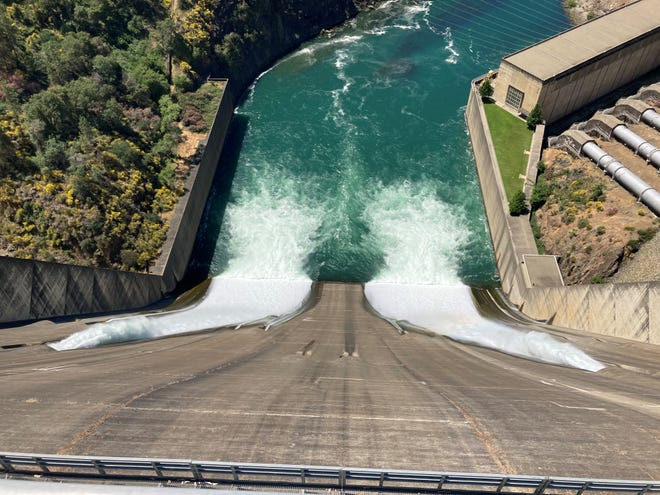 Water is released Tuesday, May 18, 2021 from the spillway at Shasta Dam where operators said they are looking at some of the driest conditions in at least the past 44 years.