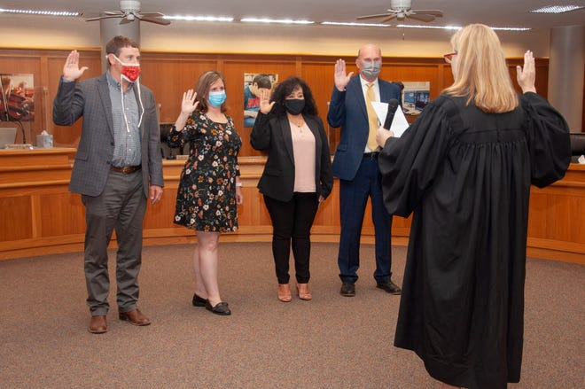 Judge Carmen Dusek swears in four trustees to the San Angelo ISD school board Monday, May 17, 2021. Facing the camera from left to right: Dr. Taylor Kingman, Ami Mizell-Flint, Lupita Arroyo, and Bill Dendle take their oath of office. Kingman, Mizell-Flint, and Dendle won reelection. Arroyo is the newest board member and represents Single-Member District 2.