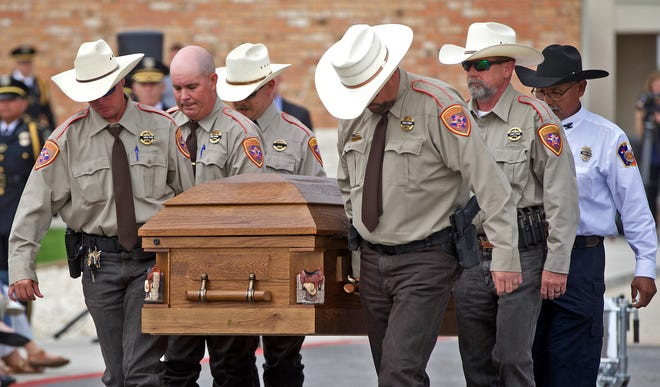 Law enforcement officers carry Stephen Jones' casket after a memorial service at PaulAnn Church on Wednesday, May 19, 2021. Jones, a deputy with the Concho County Sheriff's Office, was killed in the line of duty in Eden last week.