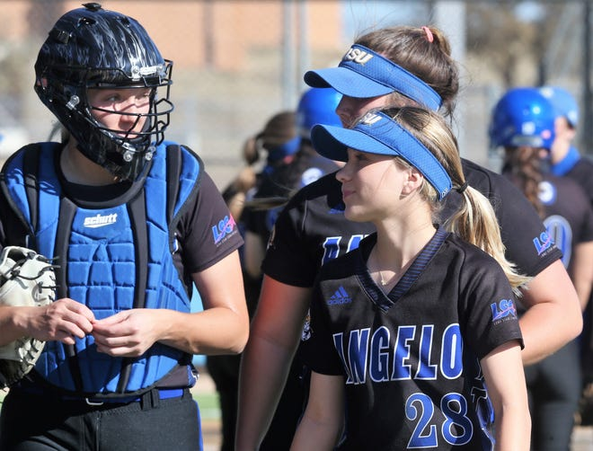 Angelo State University infielder Ashlyn Lerma, 28, chats with catcher Keilei Garcia during a game earlier in the 2021 season.