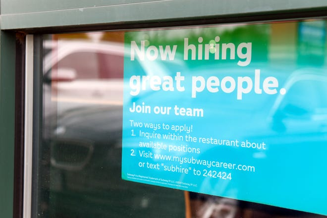"""A """"now hiring"""" sign is hung in the window of Subway on Wednesday, May 19, 2021 in Sioux Falls."""
