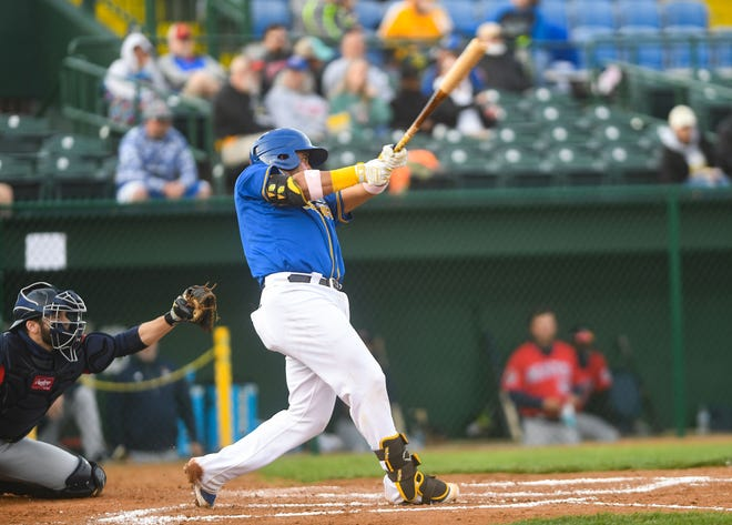 Canaries' Charlie Valerio takes a swing at the ball during the season opener against the Winnipeg Goldeyes on Tuesday, May 18, 2021 in Sioux Falls.