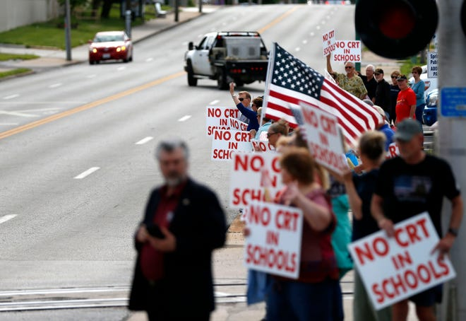 Protesters gather to protest critical race theory being taught in Springfield, Mo., schools on Tuesday, May. 18, 2021.