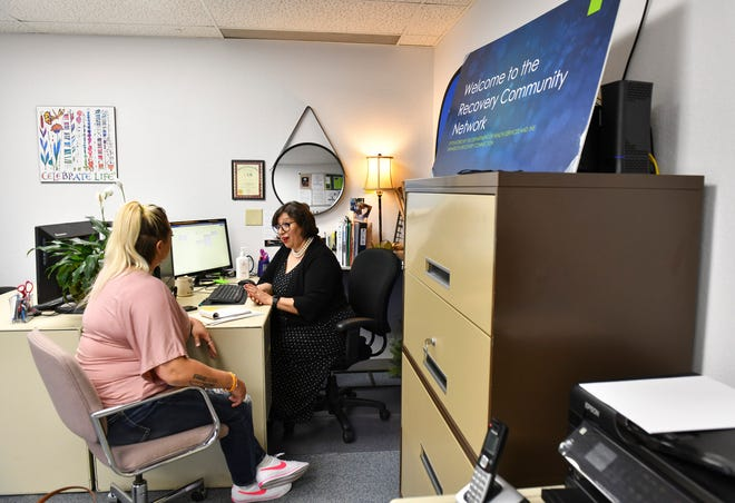 Maddie Moilanen talks with her sponsor and Recovery Community Network assistant director Cynthia Magallanes Tuesday, May 18, 2021, in St. Cloud.