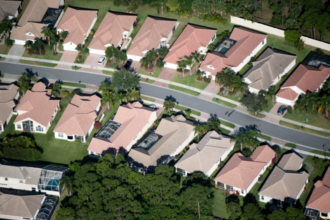 Homes line a street in western Port St. Lucie seen in an aerial image Tuesday, April 6, 2021. The growing city is the most populated on the Treasure Coast and is in the top 10 biggest cities in Florida.