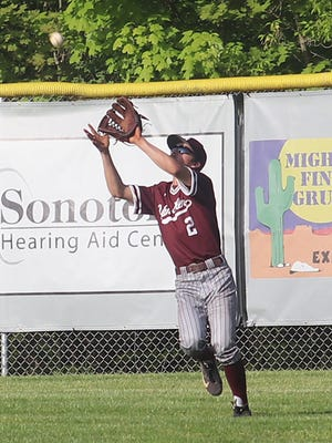 John Glenn's Kale Denny hauls in a fly ball in right field during Tuesday's Division II sectional championship game with St. Clairsville