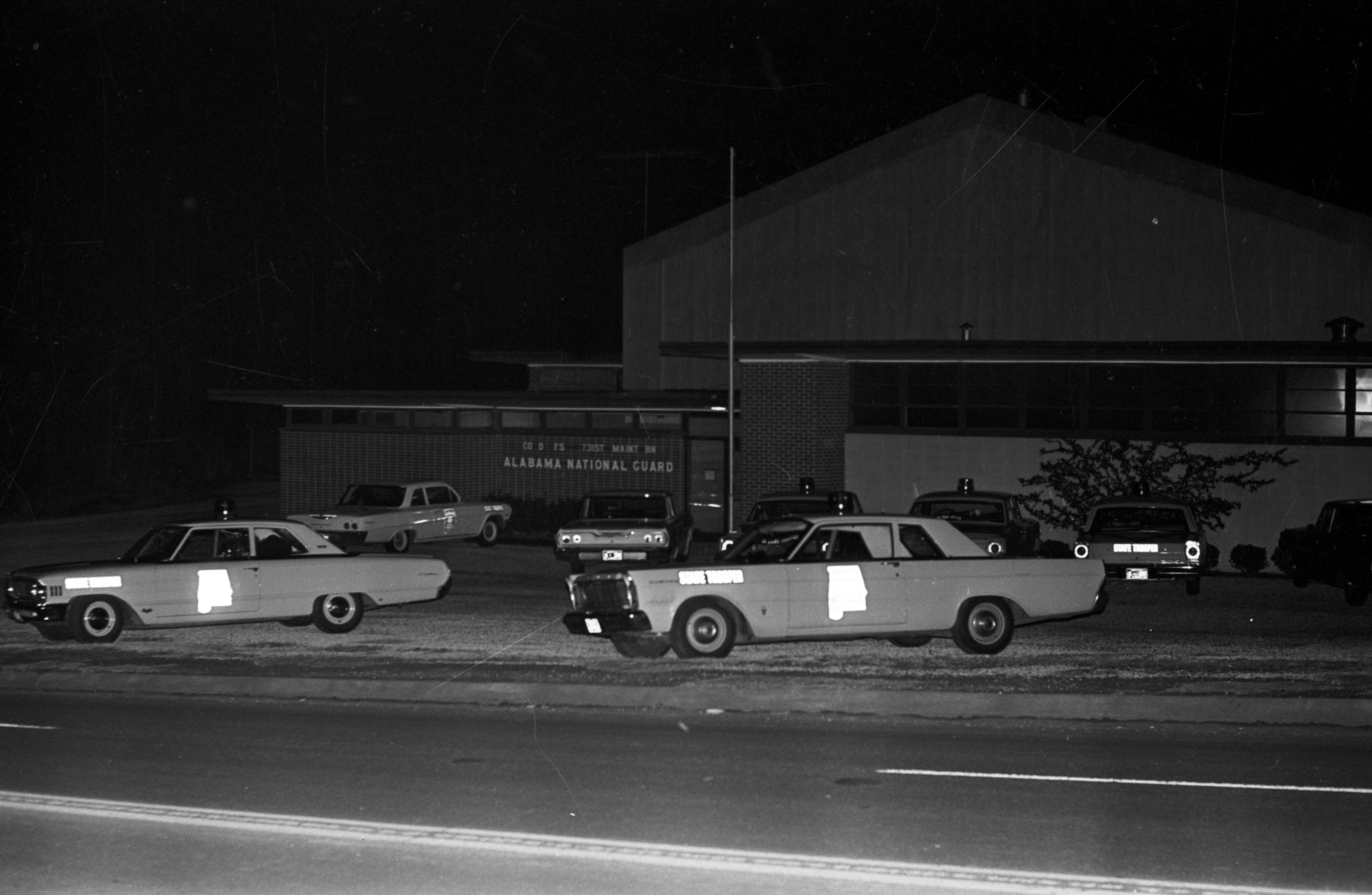 State troopers parked in front of the National Guard armory in Marion, Alabama, the night of the civil rights demonstration during which Jimmie Lee Jackson was shot.