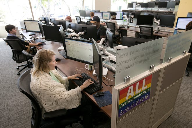 Advocates with the National Domestic Violence Hotline take calls at the Austin headquarters. The city of Austin approved a contract Thursday with the SAFE Alliance to operate a domestic violence shelter out of a hotel initially purchased to house Austin residents experiencing homelessness.
