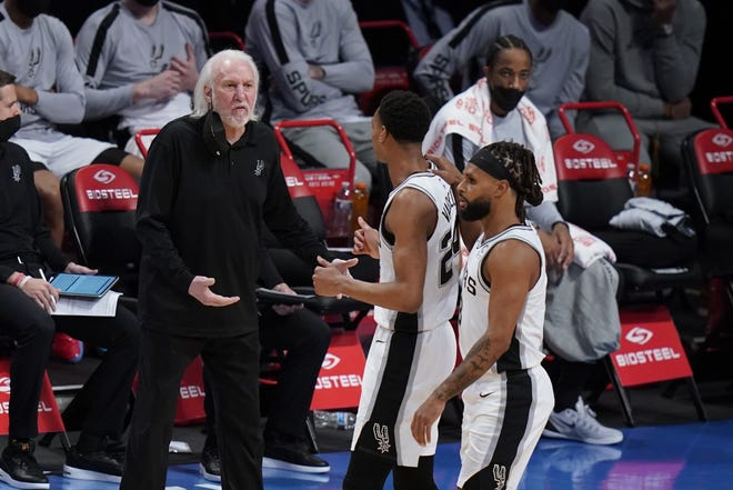 San Antonio coach Gregg Popovich talks to his players during a May 12 game against the Brooklyn Nets. The Spurs missed the playoffs for the second straight year after Wednesday's loss at Memphis. Now Popovich must decide if he wants to return for a 26th season.