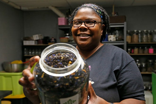 Precious D. Jones, owner of Me Plus Tea, poses for a portrait with her most popular tea, Creamy Earl, at her workshop in Athens, Ga., on Thursday, May 13, 2021.
