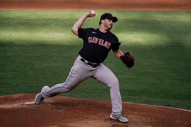 Cleveland starting pitcher Aaron Civale throws against the Los Angeles Angels during the first inning of a baseball game, Wednesday, May 19, 2021, in Anaheim, Calif. (AP Photo/Jae C. Hong)