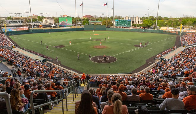Texas takes on rival Texas A&M in front of a sellout crowd at UFCU Disch-Falk Field in April 2019. Starting this weekend, university officials will allow 100% capacity at home softball and baseball games.