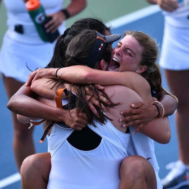 Texas seniors Anna Turati, right, and Fernando Labraña hug after Labraña's 6-2, 2-6, 6-3 win over Florida State's Andrea Garcia clinched the regional finals.
